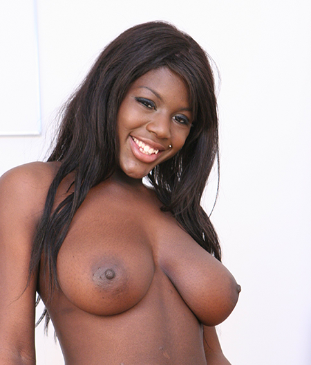 Black phone sex girl, Shanice poses topless showing off her full tits and blowjob lips
